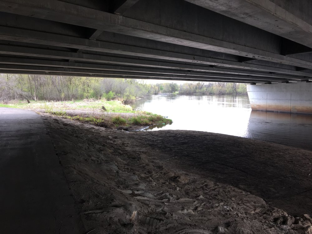 View from under the Bunker Lake Boulevard bridge down the Rum River