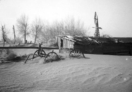 The aftermath of a dust storm, burying farm equipment and building (photo courtesy of american-historama.org)