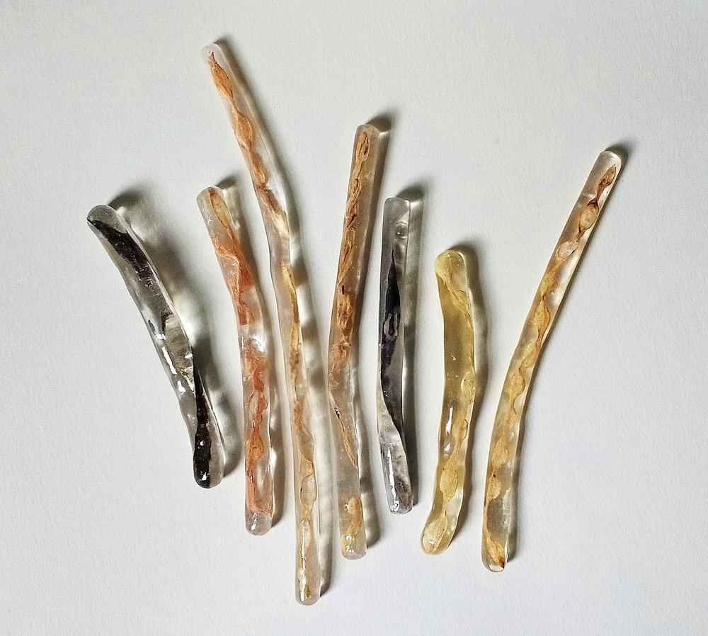 Cynthia Scott,  Podz,  2017. Dried bean pods, resin