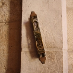 Need a Mezuzah?   We can help you purchase a mezuzah for your home and office and properly affix it to the door.   Contact us   for details or for help obtaining any other Judaica items.