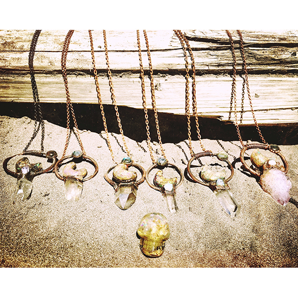 """MoonKeys charging and cleansing at """"the beach"""" (river lol) with one of my vibrant sacred stone skulls."""
