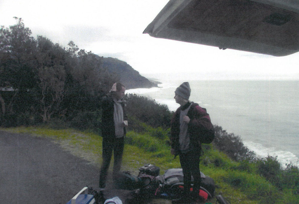 Packing up the morning after. Just behind Curtis and Snowy is the Headland that features on the cover of Beauty Point.