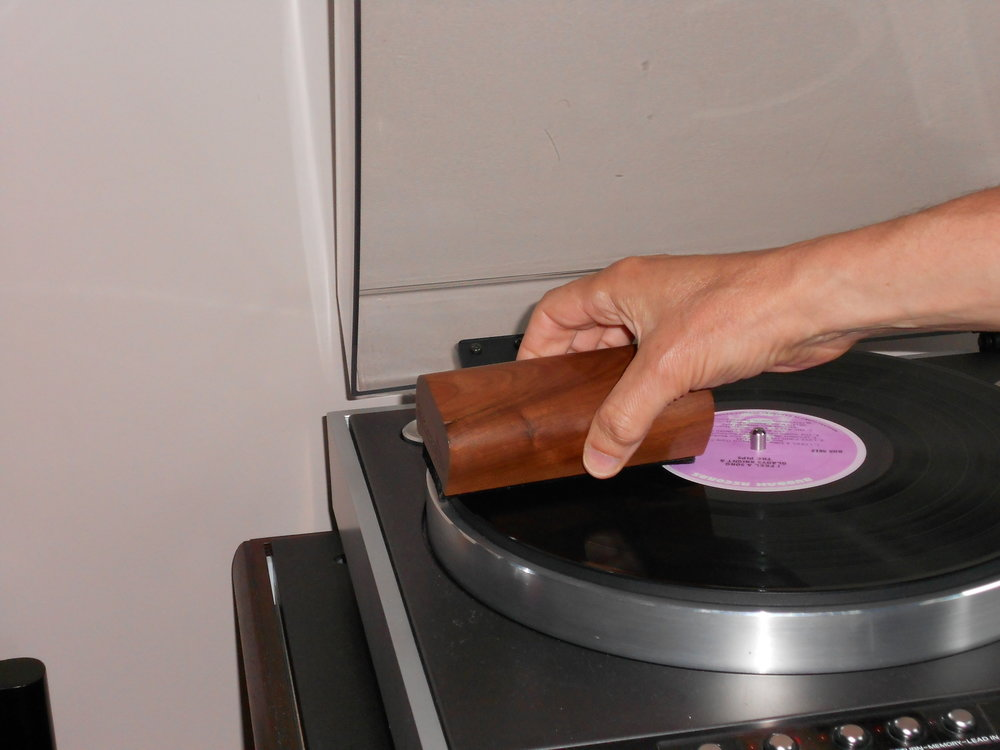 Use the other edge of the brush to dry the record off.