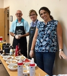 Manatee Community Based Care Ice-Cream Social.  Left to right: YFA CEO Mark Wickham, Marnie Keller, VP of Case Management and Ashley Vaughn, Assistant Program Director, lending a hand.