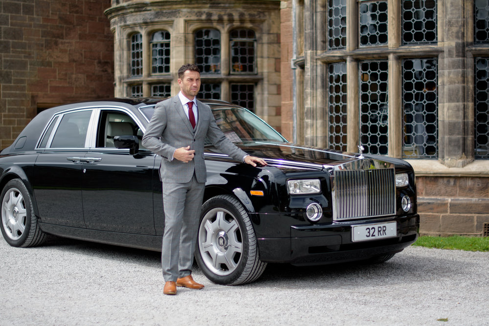 Groom standing with his Rolls Royce