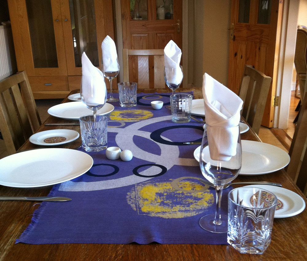 Set table with purple runner.jpg