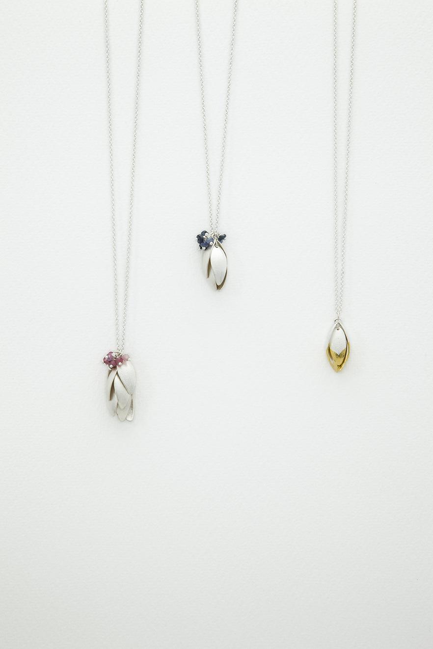 2 silver nestling pendants.jpg