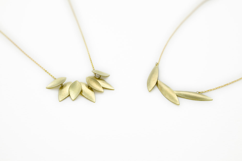 18ct Sunflower Pendant and Plume Pendant