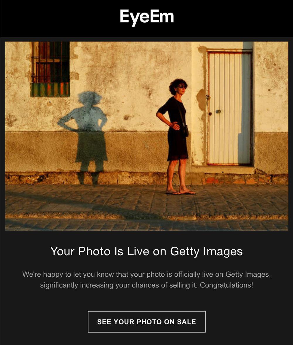 EyEM_YourPhotosLifeOnGettyImagres_WomanStandingAgainstHouseDuringSunset.jpg