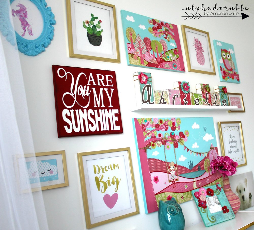 girl's pink turquoise gold gallery wall