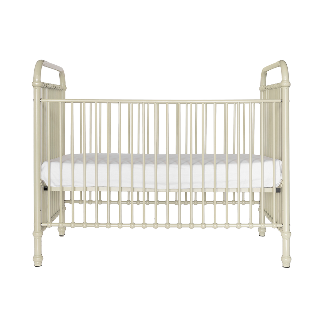 white vintage look iron crib