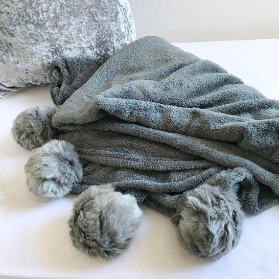 pom pom blanket grey