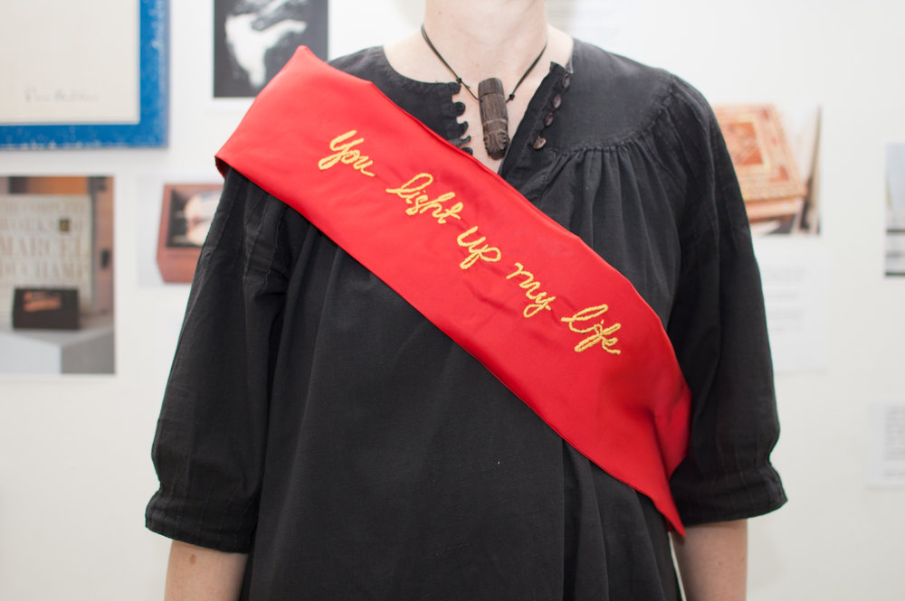 "You light up my life , Award Sash: vintage satin, embroidery thread, 8 x 48"", 2013 (Photograph: Ashley Wood)"