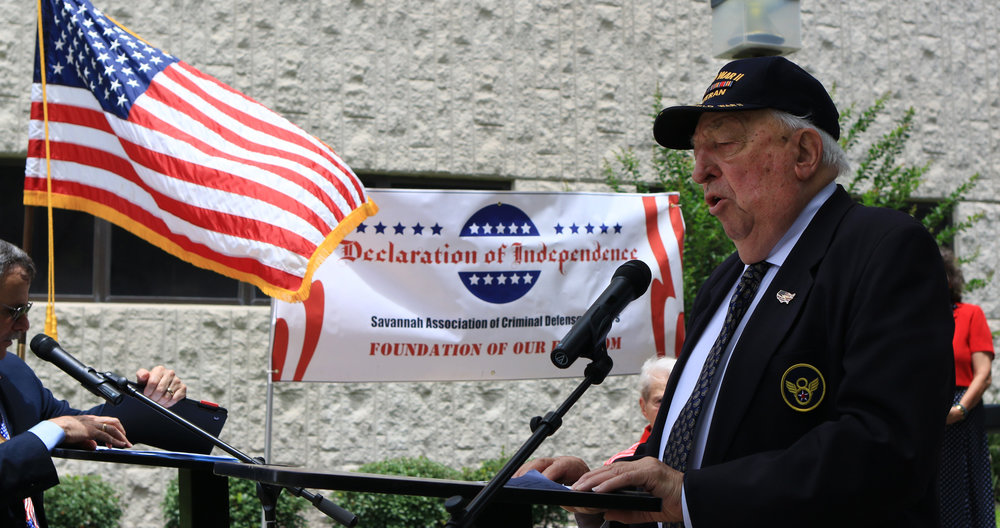 "World War II veteran Paul Grassey, who flew B-24 bombers for the Mighty Eighth Air Force, sings ""God Bless America"" in July 2016 in front of the Chatham County Courthouse after local community leaders and elected officials read the Declaration of Independence.   (Dash Coleman/Savannah Morning News)"