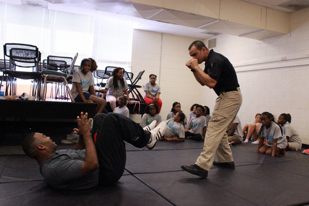 Savannah-Chatham police Sgts. Aaron Washington, left, and Hiram Rivera demonstrate self-defense techniques in June 2015 at Savannah State University during one of two girls' weeks of the police department's youth summer camp.  (Dash Coleman/Savannah Morning News)