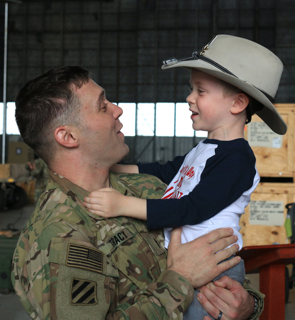 Chief Warrant Officer 2 Jon Tracy, hugs his 4-year-old son, Everett on Feb. 8, 2017, at Hunter Army Airfield after a 9-month deployment in Afghanistan. Tracy, a soldier in the 3rd Squadron, 17th Cavalry Regiment of the 3rd Infantry Division's 3rd Combat Aviation Brigade, was one of 16 local soldiers returning to the U.S.  (Dash Coleman/Savannah Morning News)
