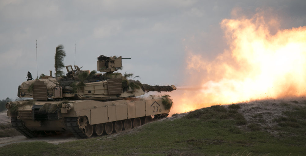 An M1A2 Abrams battle tank fires a 120-mm round downrange Feb. 15, 2017, at Fort Stewart during a combined arms live-fire exercise conducted by the 3rd Infantry Division's 1st Armored Brigade Combat Team.  (Dash Coleman/Savannah Morning News)