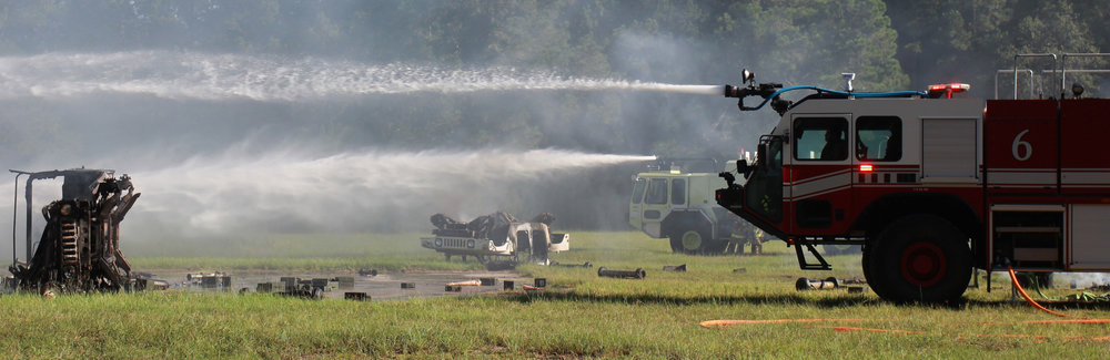 Army firefighters spray water at a smoldering Humvee one August morning at Hunter Army Airfield during Stewart Guardian 16. The training operation simulated how the Army would respond to a transport plane loaded with ammunition crashing on the installation, killing the crew in the impact and subsequent fires. The drill tested multiple units from Fort Stewart/Hunter Army Airfield, including firefighters, EMS, explosive ordnance teams, investigators and public affairs.  (Dash Coleman/Savannah Morning News)