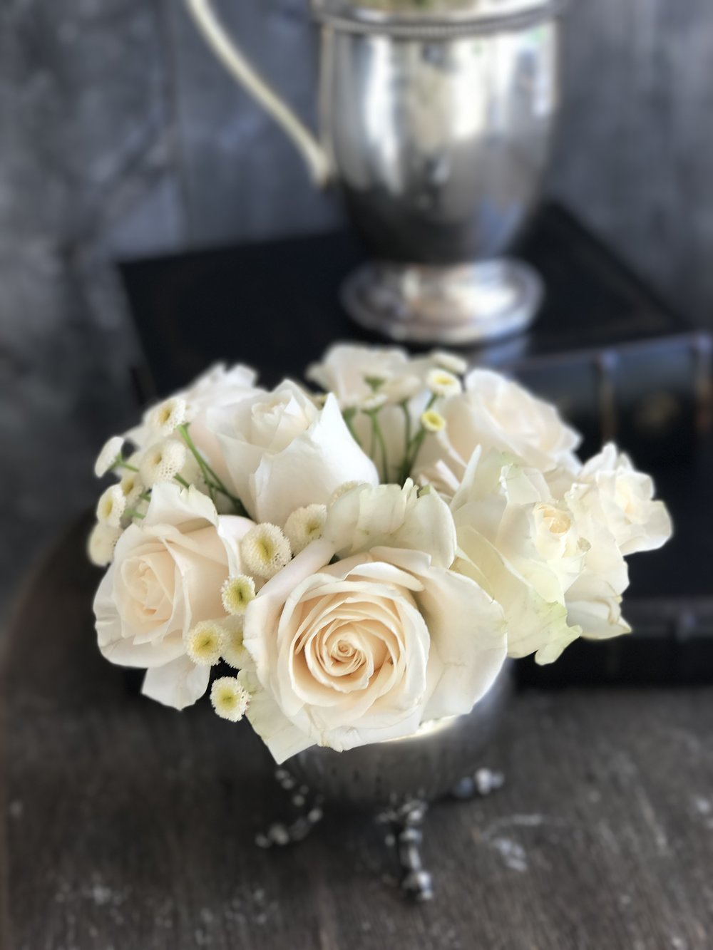 Roses and vintage silver next to reclaimed wood...a perfect combination!