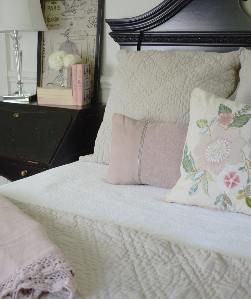 These accent pillows and throw were warmed up by the addition of the linen euro squares and duvet cover.