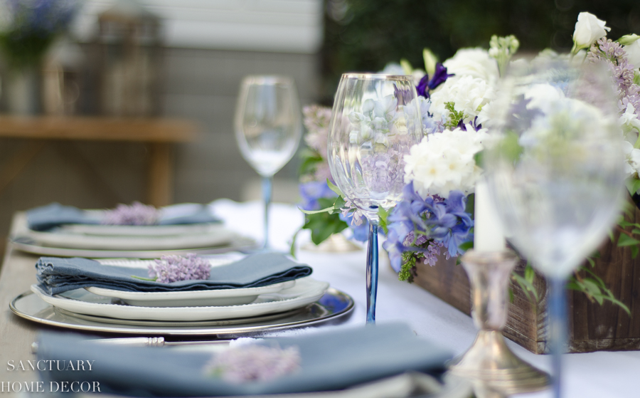 On this spring table, I used accents of blue in the flowers and napkins to bring in some color.