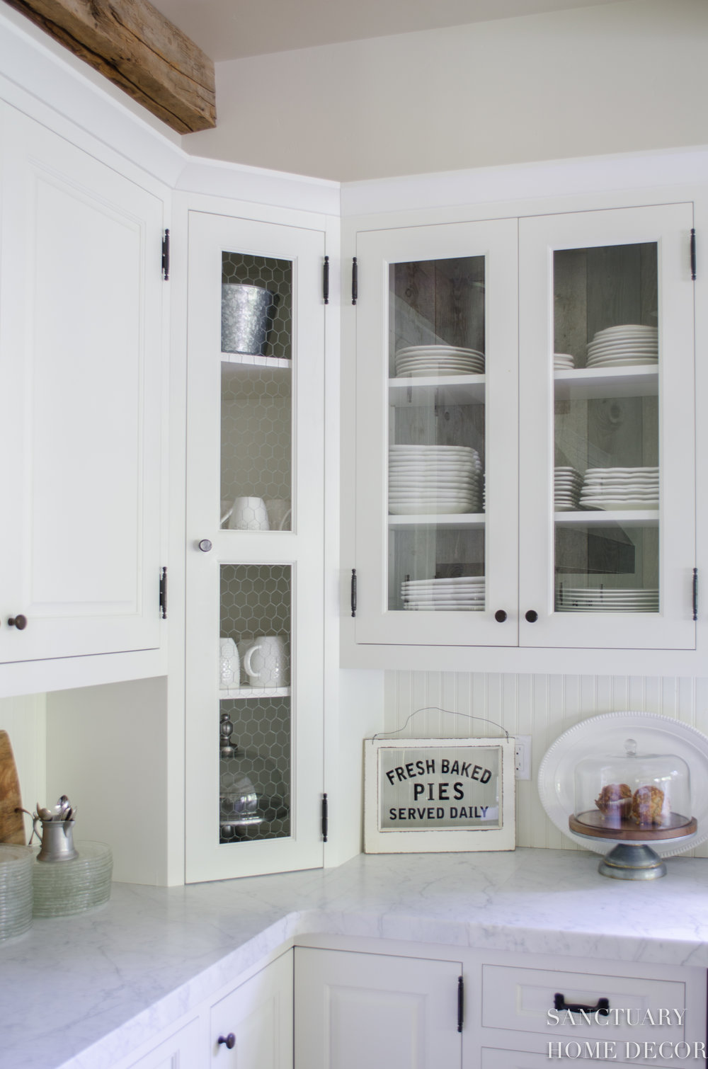 All White Dishes inside  Glass Cabinets at the Ranch