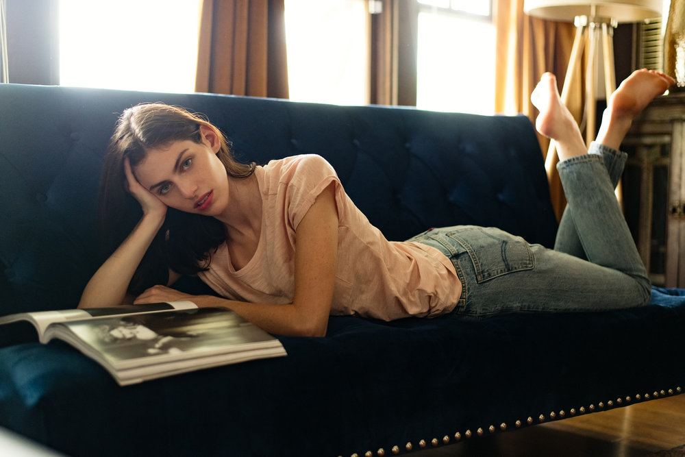 FashionLifestlye-model-reading-magazine-couch.jpg