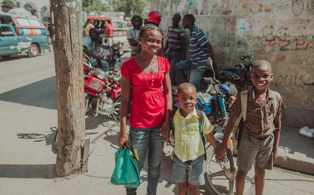 A Mother & her boys.  Photographed on the streets of Port Au Prince.