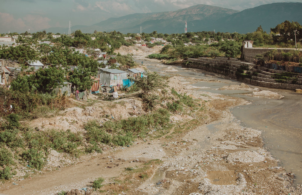 In this area, you'll see people burning trash at night because there is no sanitation department in Haiti.