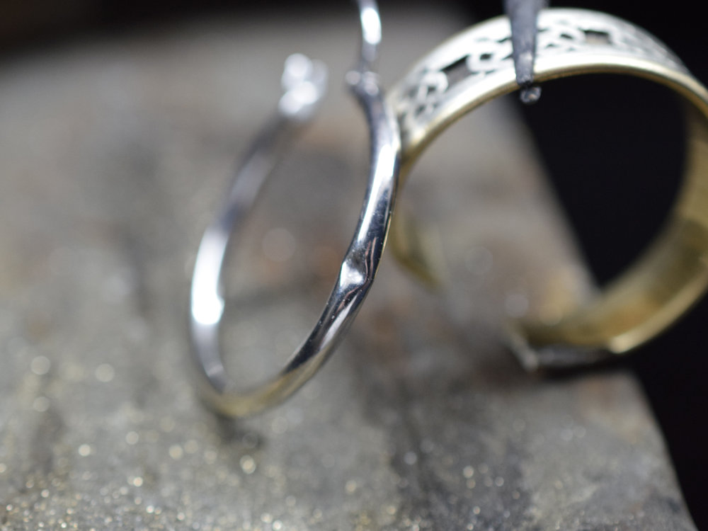 Common hoop earring with a dent.