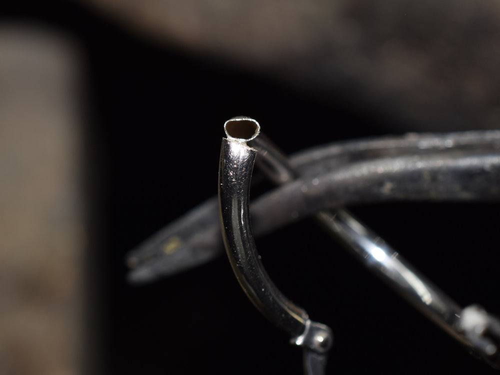 Hoop earring made from .08mm thin tubing.