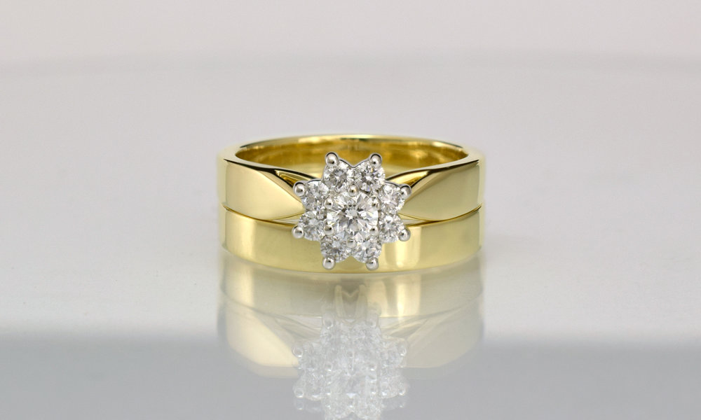 Wedding ring made wider to space the third ring and reduce rubbing.