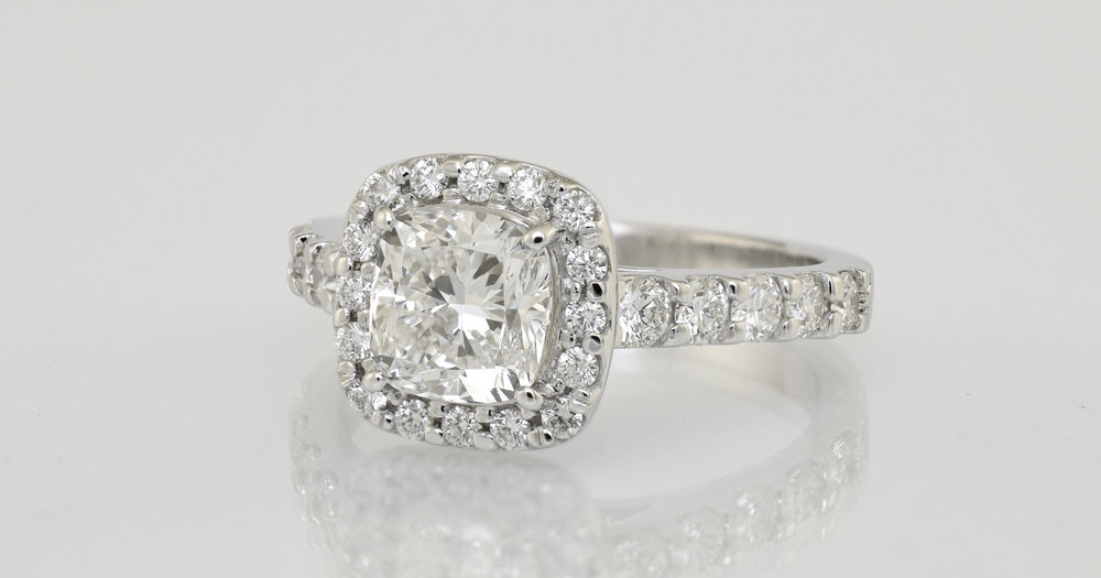 2 -  .90 carat main diamond, cushion cut. Total diamond weight 1.30 carats