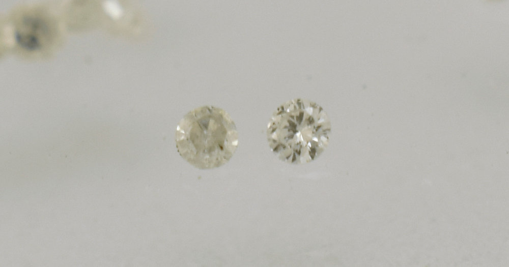 Diamond from the ring on the left. To the right F colour Vs clarity diamonds we replaced them with.