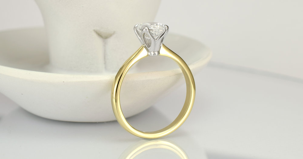 1 carat cushion cut in a temporary ring.