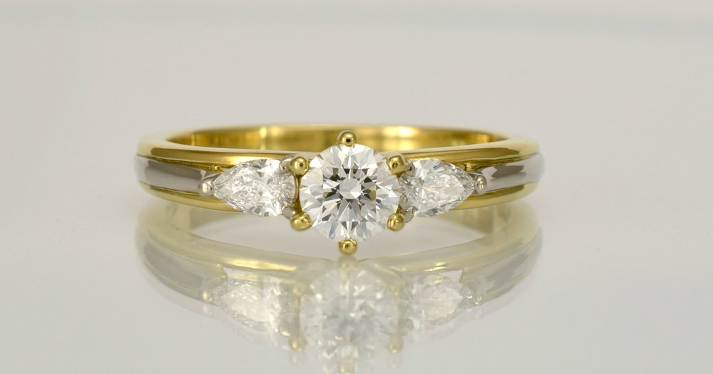 DR483 - 18ct gold alloys, .40ct main diamond with 2 x .125carat accent diamonds.