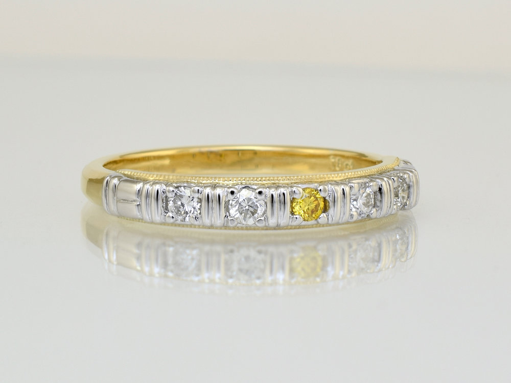 The white diamonds were sourced from other unwanted pieces to be used in this ring.