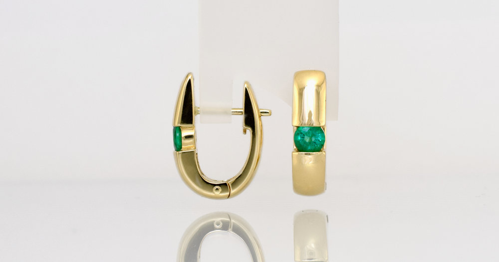 Natural Emeralds set in 18ct yellow gold clip hoop earrings.