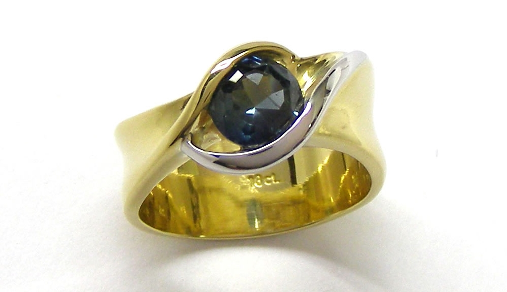 A Sapphire ring I made over 10 years ago would be the design start.