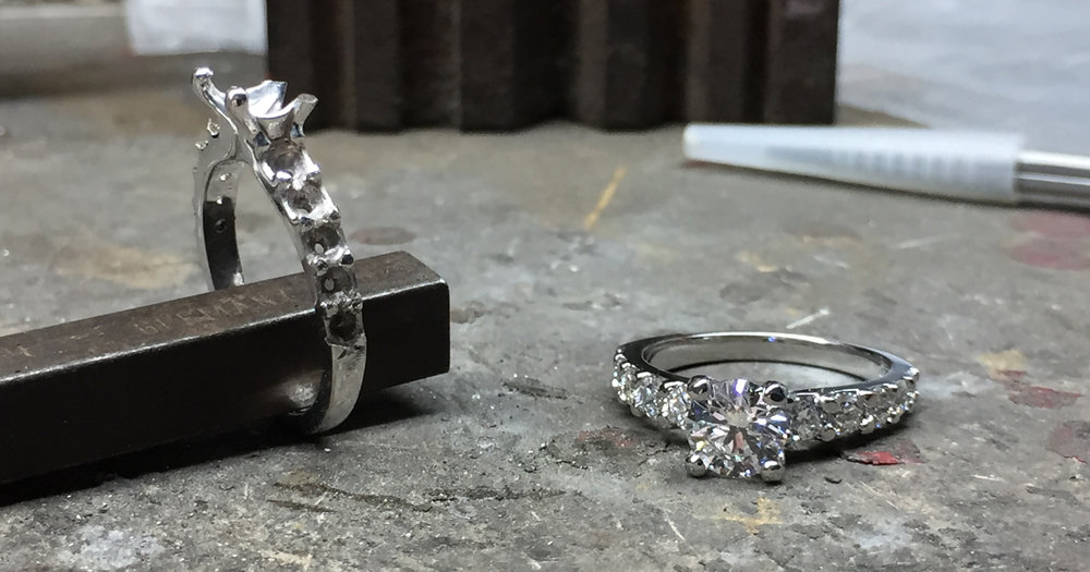 Nearly finished Platinum ring on the right, unset proposal ring on the left.