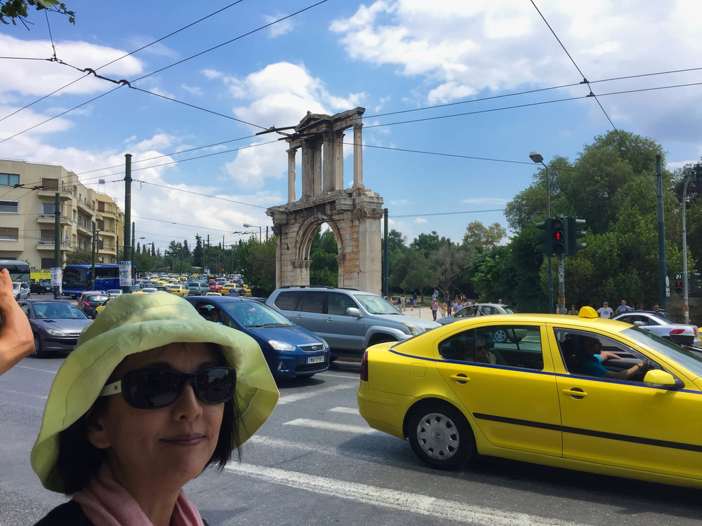 Just outside the gate to the Temple of Olympian Zeus. Really hot now and someone is tired I think.