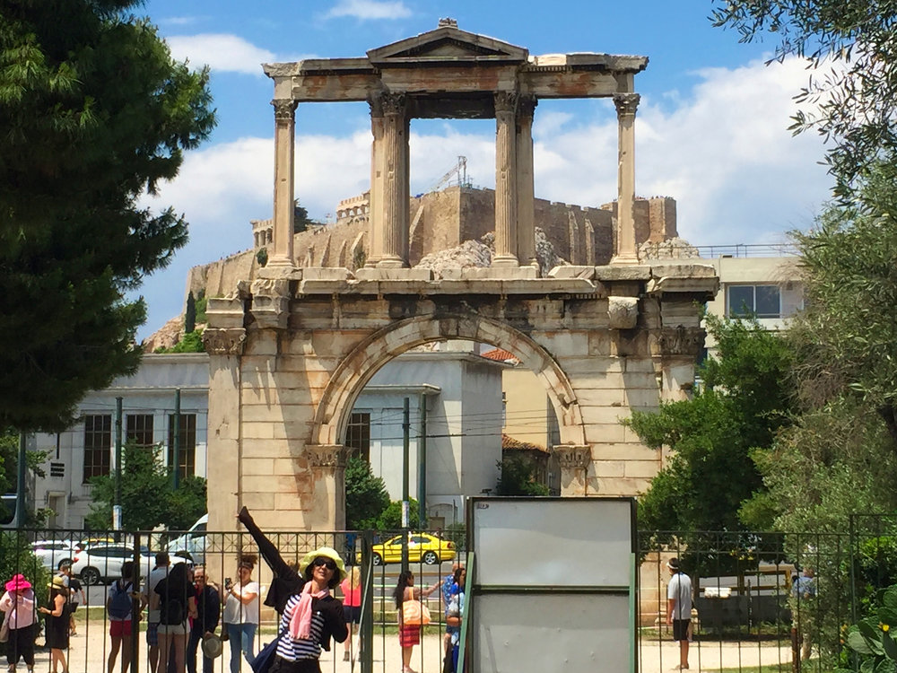 The view from inside the gate back up to the Acropolis. You have to pay to get in so many take photos from outside.
