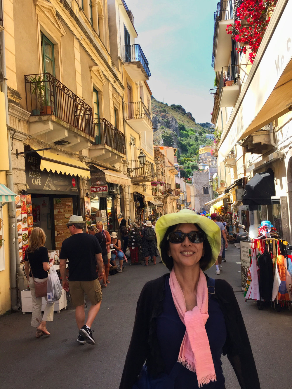 Walking through the shopping area of Taormina to catch the bus and then train back to the port of Messina.