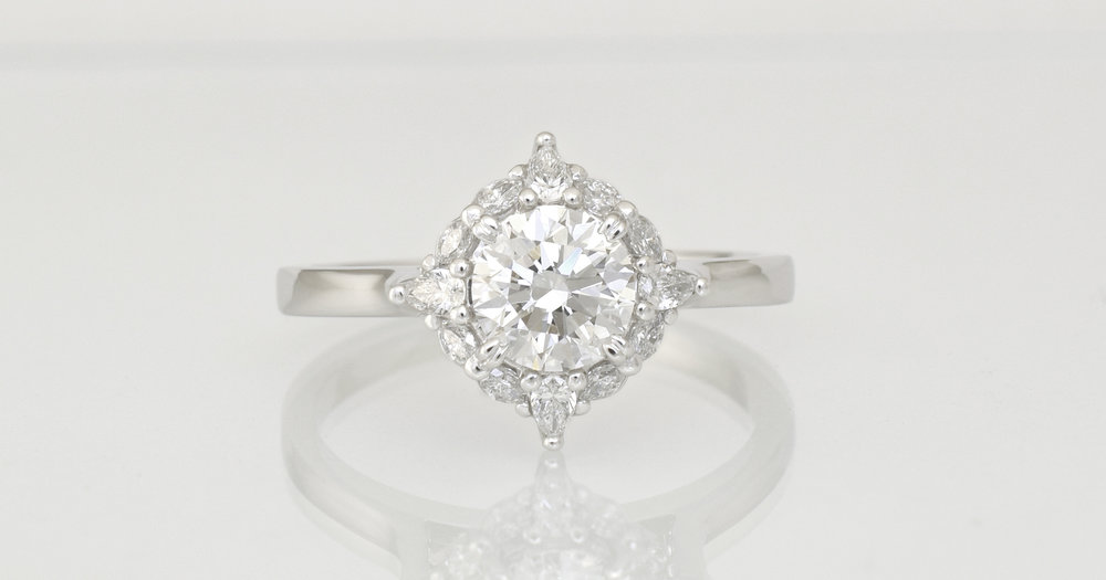 The design scaled to her finger size and the diamond specification he desired to his budget.