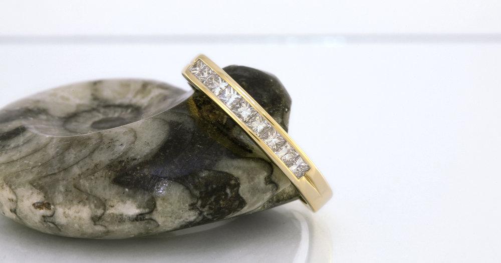 .45 carats of channel set princess cut diamonds.