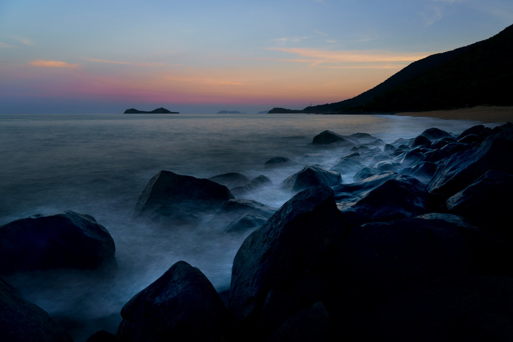 North of Ellis Beach at sunset looking back to Wangal Djungay and Palm Cove.