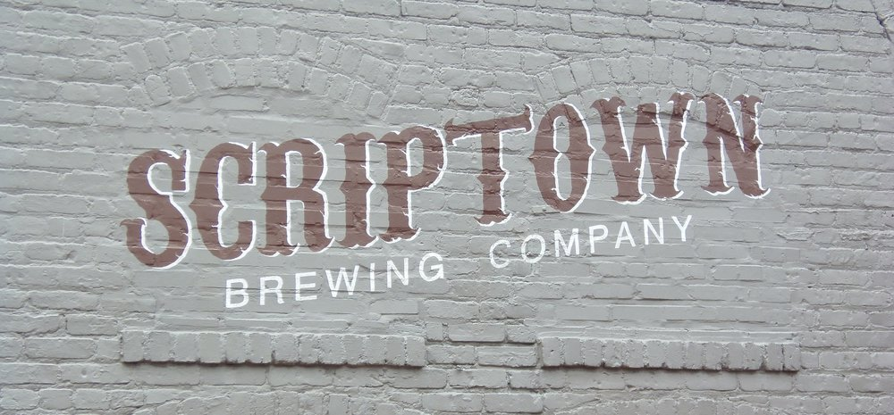 The back of the building where Scriptown letters stand out beautifully on the gray bricks