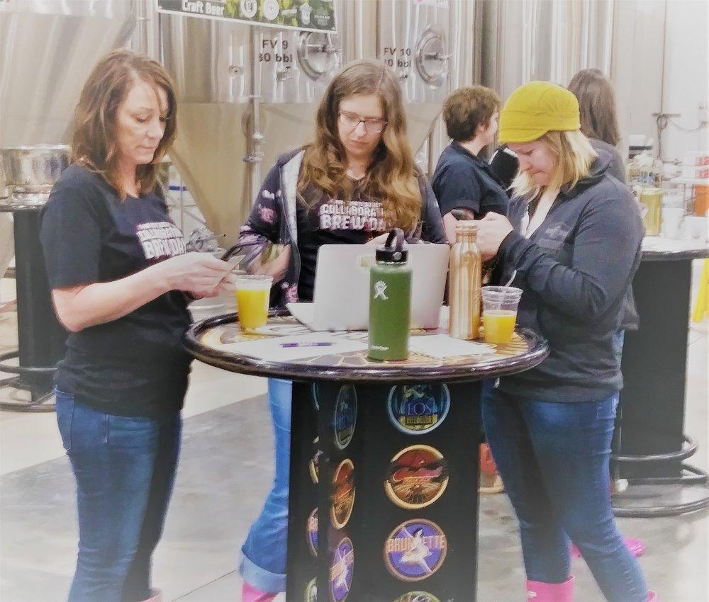 Kim Kavulak, Gabriela Ayala, and Megan Arrington-Willams getting registration ready