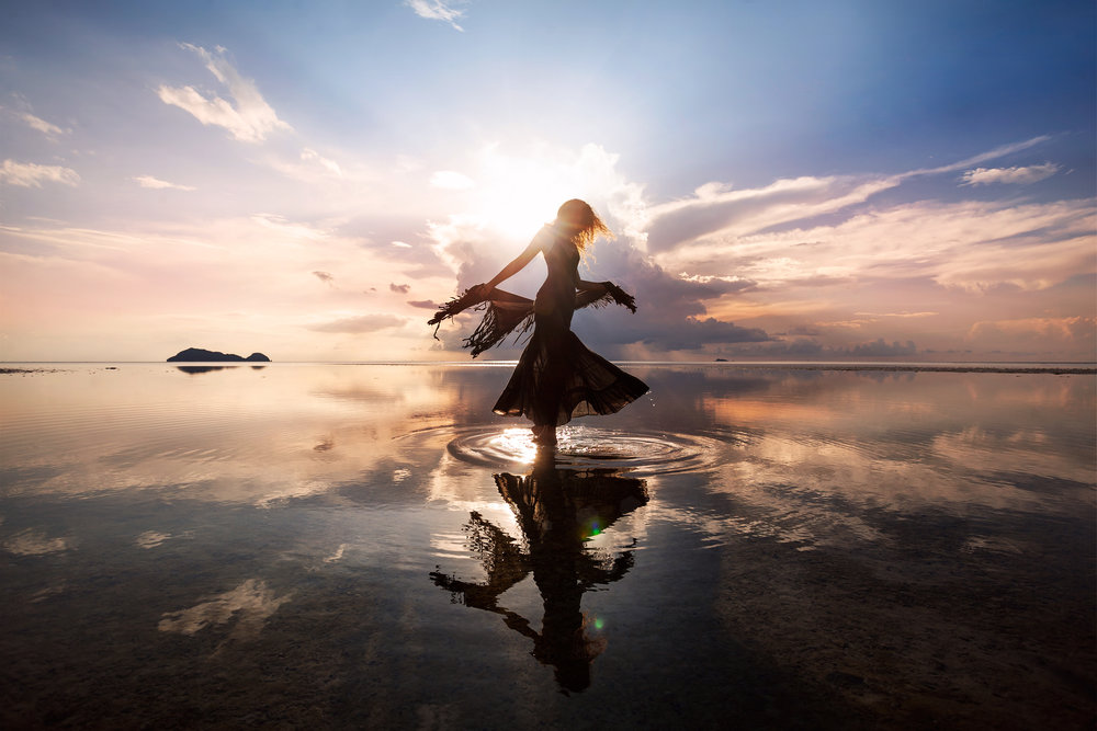 Woman Dancing on Water Sunset Silhouette 13526433.jpg