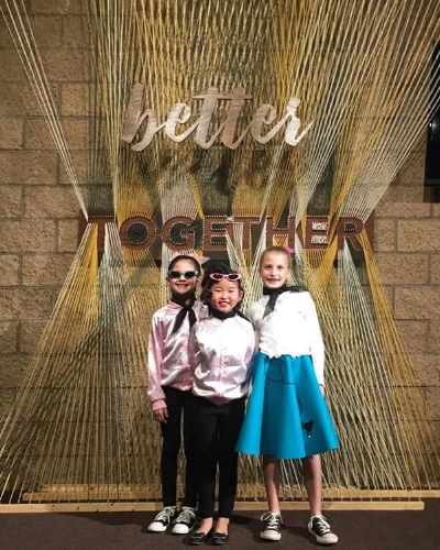 Second graders Sophie Hsu, Sophie Ly-Pang, and Megan Demeter (left to right) were a few of the outstanding performers from the act,  Rock Around the Clock.
